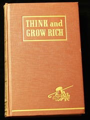 """PNI Book sale still draws buyers """"Think and Grow Rich,"""" by Napoleon Hill. Offers to teach, for the first time, the famous Andrew Carnegie formula for money-making, based on the Thirteen Proven Steps to Riches based on 25 years of research and in collaboration with more than 500 distinguished men of great wealth, who proved by their own achievements that this philosophy is practical. Published in 1937 by The Ralston Society, Meriden, Conn. First printing. No dust jacket. $500."""