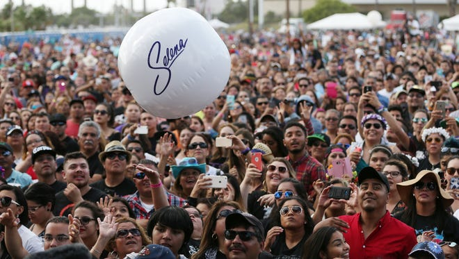A Selena beach ball bounces around the crown at Fiesta de la Flor on Saturday, May 7, 2016.