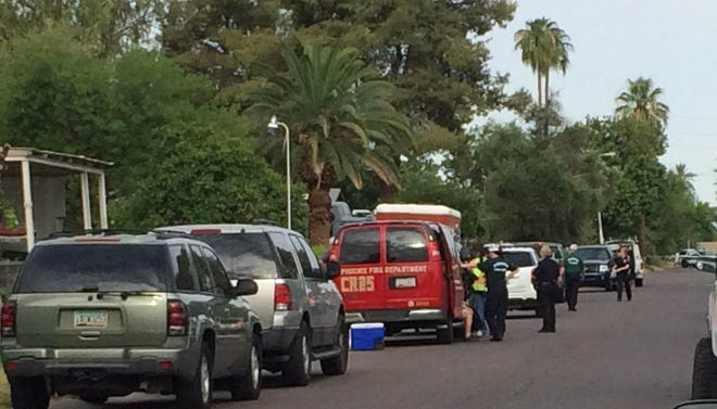 The scene of a standoff between Phoenix police and a man who has barricaded himself inside a house.