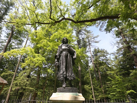 A statue honors, and marks the grave of Mary Jemison,