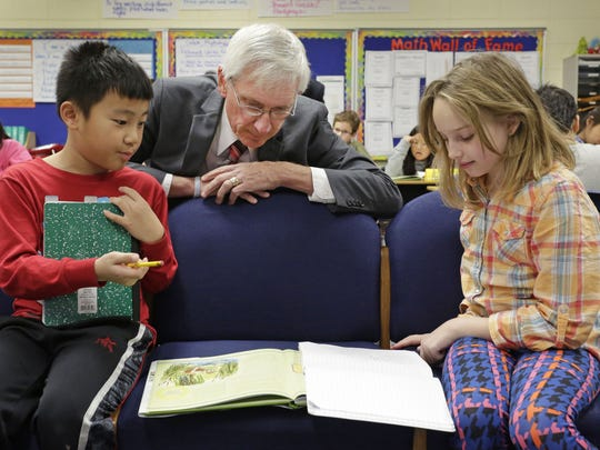 State Superintendent of Public Instruction Dr. Tony Evers looks over work by Sheboygan fourth graders Matthew Chang and Sophia Ranieri during a visit in December.