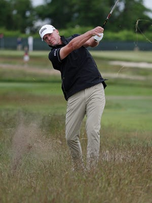 Steve Stricker hits out of the fescue on the fourth hole during the second round of the U.S. Open on Friday.