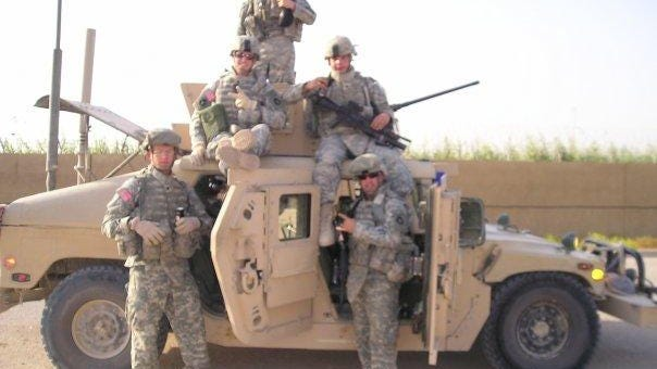Ryan O'Leary, seated at right on top of Humvee, while serving in Iraq with the Iowa National Guard in 2007-08.