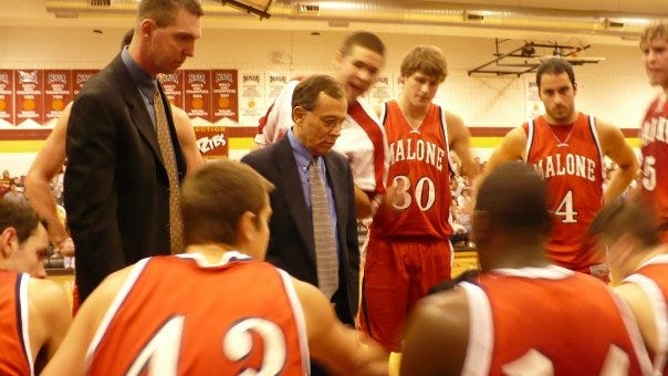Greg Bryte, left, shown during his Malone coaching days.