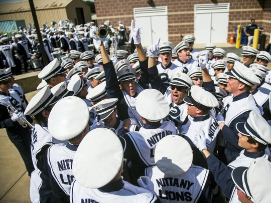 Trumpet players gather together for a cheer outside the Blue Band Building before the start of Penn State's Sept. 26 game against San Diego at University Park's Beaver Stadium in State College.