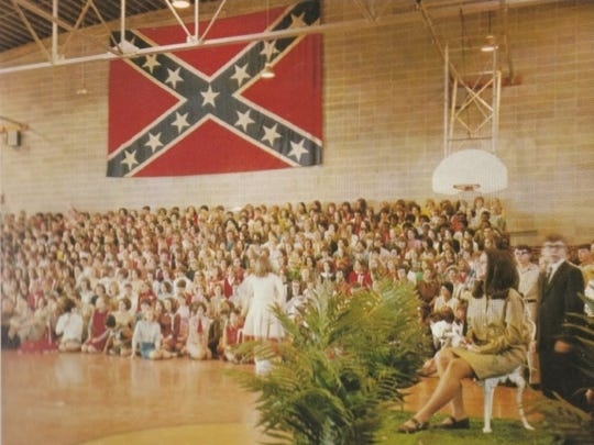 A Confederate flag hangs in the Robert E. Lee High School gym during a school assembly. This photo can also be viewed in the school's 1968 yearbook.