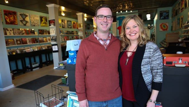 """Travis Searle and Lisa Foster of Guestroom Records on Frankfort Avenue on Wednesday morning. The two decided to open a shop in Louisville after Searle's two successes in Oklahoma. """"Lisa's family is from Campbellsville, so we were coming through Louisville all of the time and in the last couple years we just saw how awesome this place was getting,"""" Searle said. """"We decided that between the music community, the local business culture, the food culture, and the beer scene, this was the place we wanted to make our home. Dec. 18, 2013"""