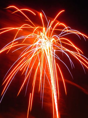 Fireworks light up the sky at the Marion County Fairgrounds.
