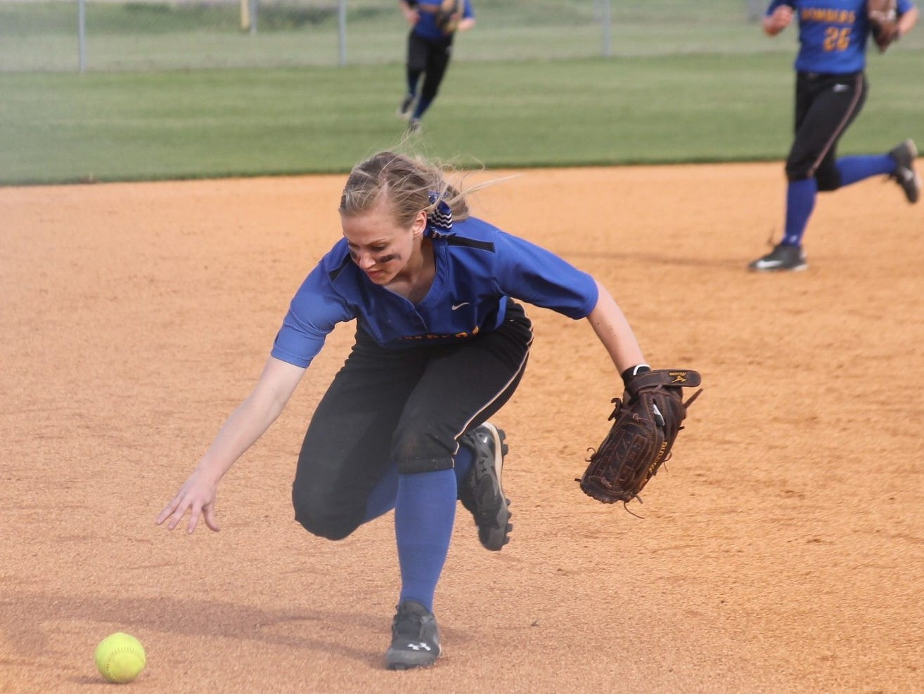 Mountain Home's Macie Kelly fields a ground ball during the Lady Bombers' 10-3 loss at Marion on Thursday night.