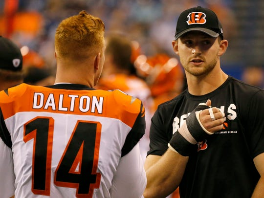 Cincinnati Bengals quarterback Jeff Driskel (6) talks with quarterback Andy Dalton (14) on the sideline after leaving the game with an injury in the third quarter of the NFL Preseason Week 4 game between the Indianapolis Colts and the Cincinnati Bengals at Lucas Oil Stadium on Aug. 31.