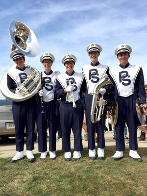 Five Northern Lebanon High School Marching Band alumni are current members of the Penn State Marching Blue Band. Pictured are, from left, Curtis Gingrich, sophomore, sousaphone; Katie Speicher, senior, clarinet; Stephanie Speicher, junior, trumpet; Neil Shook, junior, baritone; and Daniel Kreiser, sophomore, percussion. The Blue Band has 300 members.