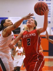 Oakland's Fiath Adams (2) goes up for a shot as Blackman's