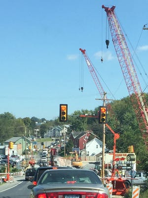 A signal controls Pa. 16 traffic, Wednesday, Sept. 27, 2017 on a single 10-foot-wide lane over the West Branch of Antietam Creek at the western boundary of Waynesboro.  The contractor is to pave the bridge on Thursday, and a week later around Oct. 12 two-way traffic will be restored to the bridge.