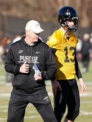 Head coach Jeff Brohm with tips for freshman quarterback Jack Plummer during the first day of Purdue spring football practice Monday, February 26, at the Bimel Practice Complex.