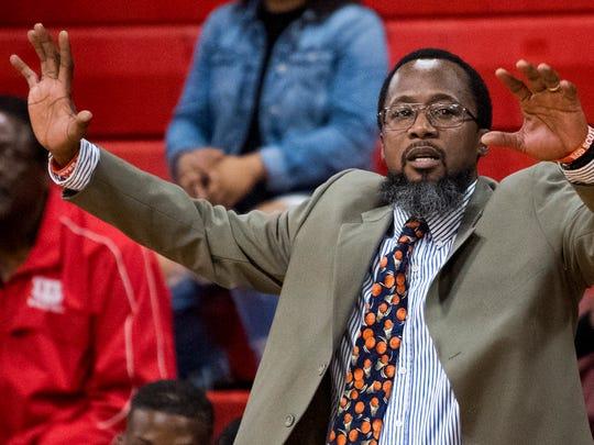 Lee basketball coach Bryant Johnson coaches against