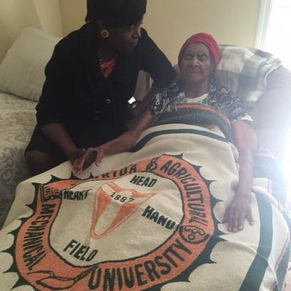 FAMU President Elmira Mangum visits with Gussie Williams