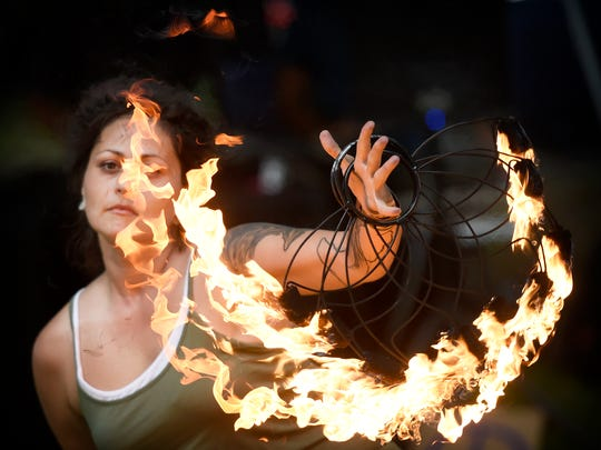 Jennifer Liggett, of Harrisburg, twirls fire during a Spinstock festival, which will be held at Coleman Memorial Park in Lebanon for the first time on Saturday, June 15.