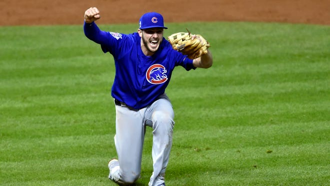 Chicago Cubs third baseman Kris Bryant celebrates after defeating the Cleveland Indians in game seven of the 2016 World Series at Progressive Field.
