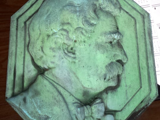 Elmira police reported Saturday they recovered this bronze plaque in good condition of Mark Twain that was stolen from a monument at Elmira's Woodlawn Cemetery, where Twain is buried with his family.