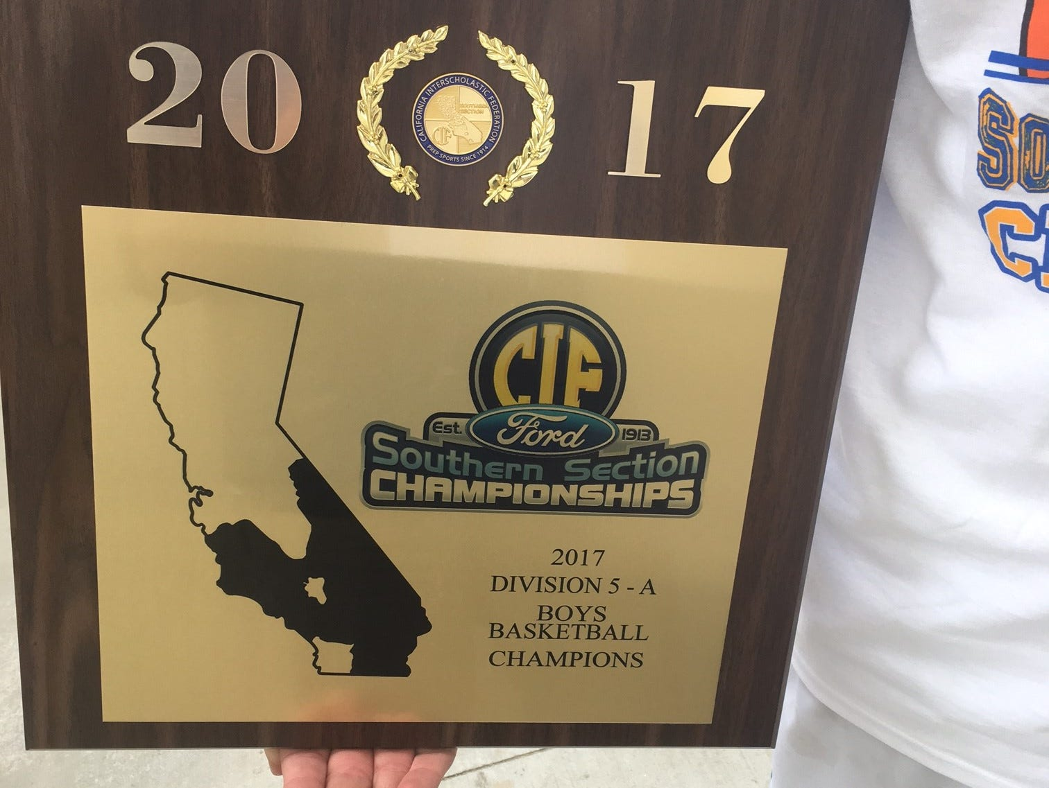 A close look at the plaque signifying that Desert Christian Academy is the Division 5A boys' basketball CIF-SS champions.
