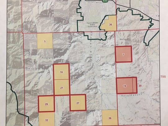A map showing the final proposed land exchanged between the U.S. Bureau of Land Management and the Agua Caliente Band of Cahuilla Indians. The two red rectangles show land going to the BLM. The yellow squares outlined in red will go to the tribe.