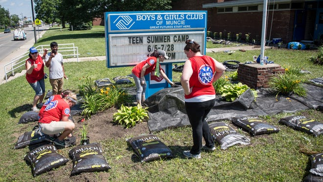 Volunteers with Lowe's Home Improvement Heroes program help give the Boys & Girls Club of Muncie a face-lift June 21, 2017, by gardening and doing other exterior projects to help revitalize the space.