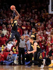 Iowa Hawkeyes guard Maishe Dailey (1) grabs a rebound as the Hawkeyes take on the Cyclones in Ames Thursday, Dec. 7, 2017.