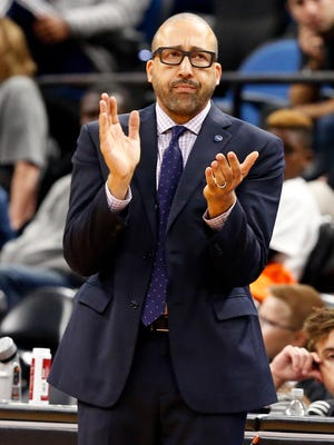 Memphis Grizzlies coach David Fizdale applauds his team during the second half of an NBA preseason basketball game against the Minnesota Timberwolves on Wednesday, Oct. 19, 2016, in Minneapolis.