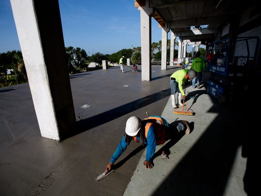 Ismael Ayadoro is part of a crew working for Manhattan Construction that is renovating Hammond Stadium. During the project, the Fort Myers Miracle are playing at JetBlue Park.