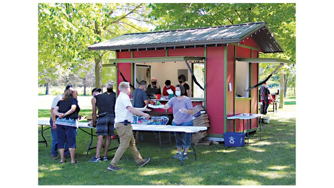 The Holiday Lights in Motion volunteers operated their food stand Friday, Sept. 4 in Sportsmen's Park -- their home away from home in the coming months!