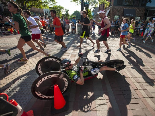 Jeremy Shortsleeve of Jericho starts his return journey down Church Street as he passes runners headed up during the People's United Bank Vermont City Marathon in Burlington on Sunday.