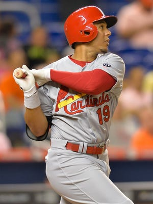St. Louis Cardinals center fielder Jon Jay (19) connects for a base hit during the seventh inning against the Miami Marlins at Marlins Park.