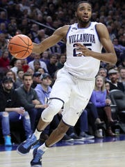 FILE - In this March 3, 2018, file photo, Villanova's Mikal Bridges plays against Georgetown during the first half of an NCAA basketball game in Philadelphia. Mikal Bridges is a possible pick in Thursday's NBA Draft. Bridges offers the desired combination of 3-point shooting and defensive ability, a valuable package in today's NBA. (AP Photo/Chris Szagola, File)