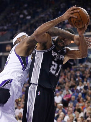 Kings center DeMarcus Cousins, left, was beat out for an All-Star spot by Spurs big man Tim Duncan.