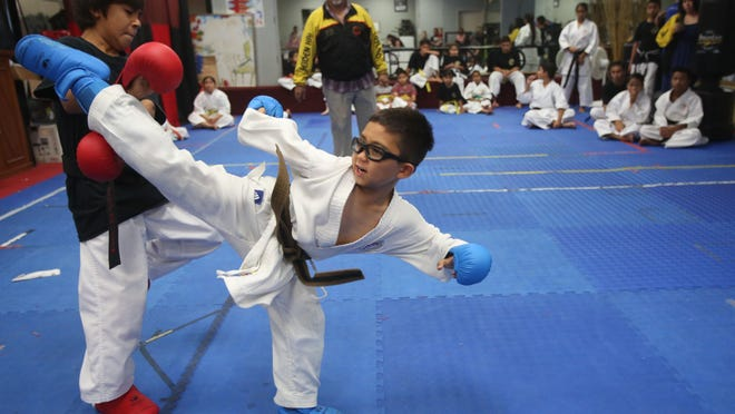 Jeremy Lopanec, delivering kick, participated in the U.S. Karate Nationals in Florida winning Silver in Kata and Bronze in Kumite in his category.
