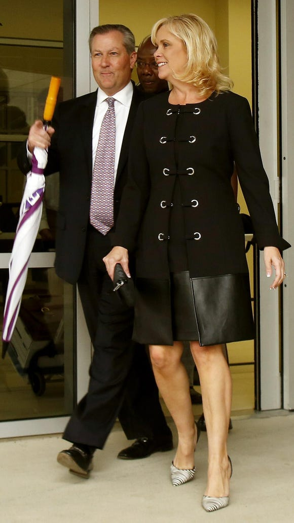 Alabama House Speaker Mike Hubbard, left, and his wife, Susan Hubbard, leave Lee County Justice Center on Monday, Oct. 26, 2015, in Opelika, Ala. Mike Hubbard faces 23 felony ethics charges accusing him of using his public positions to benefit his businesses. (Todd J. Van Emst/Opelika-Auburn News via AP) MANDATORY CREDIT