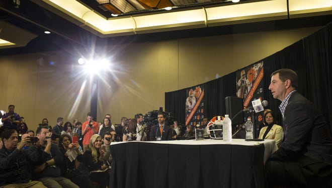 Dabo Swinney answers questions during the Fiesta Bowl Media Day.