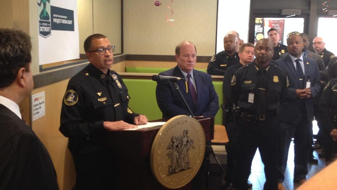 In helping promote the Green Light Project, Chief James Craig, left, with Mayor Mike Duggan, said it's crucial for businesses to help police.