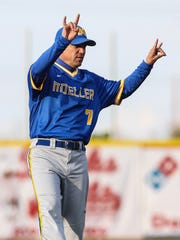 Moeller head coach Tim Held signals his players during their game with Conner at Florence Freedom Park April 30.