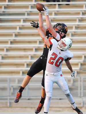 Washington's Ty Smith (15) catches a pass for a touchdown over Brandon Valley's Chase Grode (20) during a game Friday, Aug. 28, 2015, at Howard Wood Field in Sioux Falls.