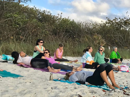 Waiting for Green Monkey's sunset beach yoga class to begin at Delnor-Wiggins Pass State Park on Monday, April 24.