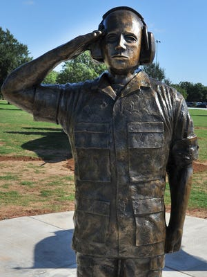 "The ""Maintenance Man"" statue is located near the Sheppard Air Force Base main gate was unveiled Friday morning during a ceremony held to celebrate Lt. General Leo Marquez."