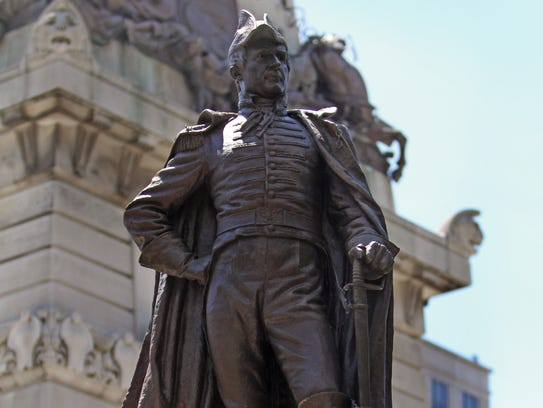 The William Henry Harrison statue is shown on Monument
