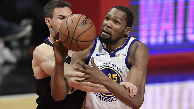 Golden State Warriors forward Kevin Durant, right, is fouled by Los Angeles Clippers forward Danilo Gallinari during the second half in Game 6 Friday. Durant finished with 50 points in the Warriors'129-110 victory.