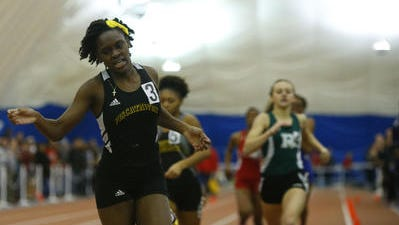 Piscataway's Khamil Evans wins the 1,600-meter run during the NJSIAA Group I and IV indoor track finals on Feb. 19, 2016.