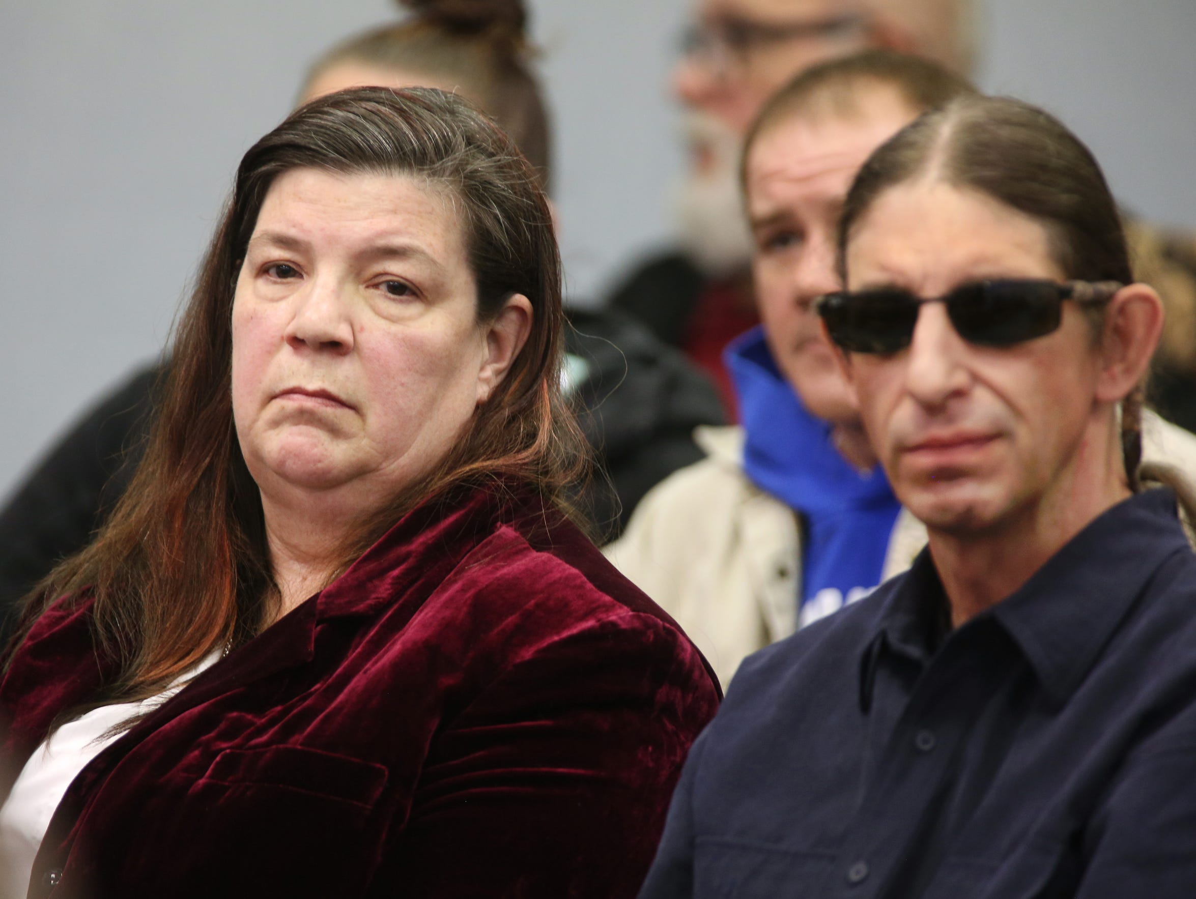 Frances Falan of Comstock Park, left, listens to testimony