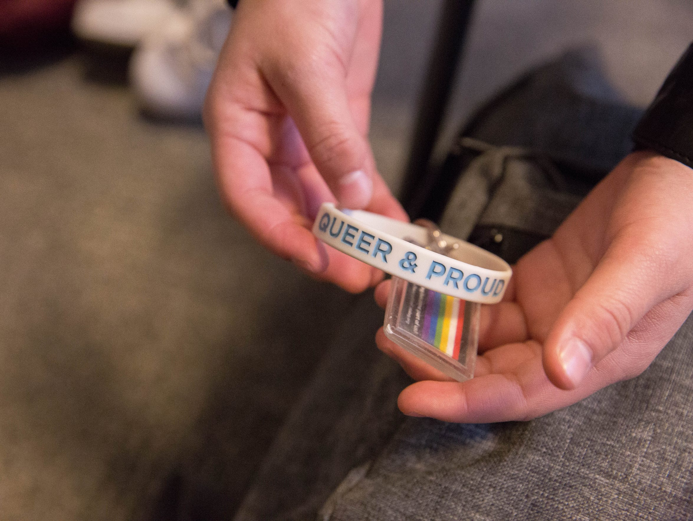 Gabe, a local transgender teen, shows off a key chain