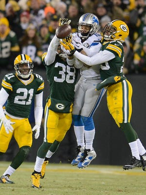 Green Bay Packers cornerbacks Tramon Williams (37) and Casey Hayward (29) break up a pass intended for Detroit Lions receiver Golden Tate (15) in the fourth quarter during Sunday's game at Lambeau Field.