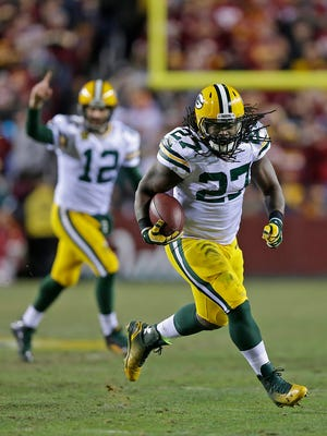 Green Bay Packers running back Eddie Lacy (27) breaks away for a run against Washington Redskins in the third quarter during the NFC wild-card round playoff game at FedEx Field.