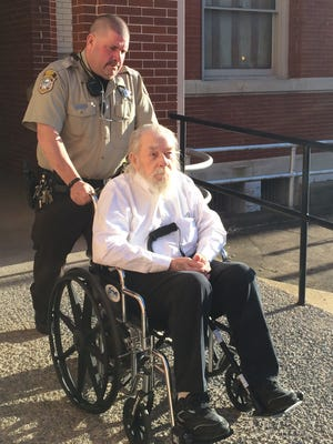 A deputy helps take Charles Almond Sr. from the Augusta County Courthouse in March after he was convicted of first-degree murder.